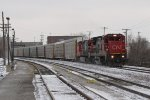 CN 2116 brushes the light dusting of snow from the rails as it leads M371 up the Holly Sub