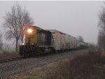 CSX 4036 leads D707-30 west on a dark and dreary late November day