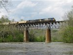 G938 rolls south over the swollen Holston River behind CSX 600 & 400