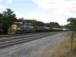 CSX 8261 switches the BIDS facility at the west end of a long cut of cars