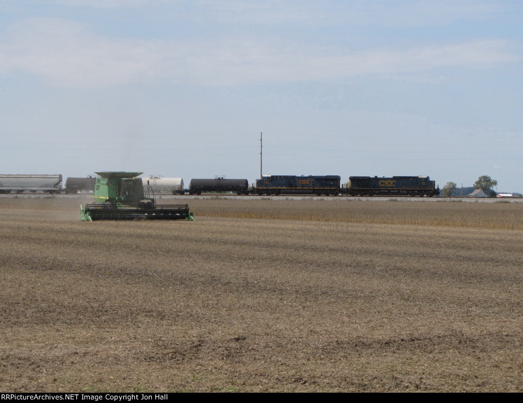 Q506 rolls by, passing fields set for harvest
