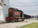 WE 3102 comes out the west end of the yard to run around a cut of hoppers