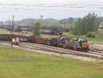 CSX 2335 & 6445 sit at the south end of the docks with a cut of scrap service gons