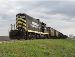 IN 1073 sits with a cut of cars on the Klink Trucking spur