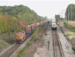 BNSF 7585 leads Q171 west on Track 1 as the tail end of Q146 heads away