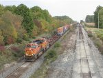 BNSF 7585 & 7696 work hard as they bring Q171 up the long grade