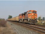 With a clear route ahead, BNSF 6090 & 5792 dig as they bring N990 up to speed