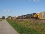 CSX 970 & 3059 shine in the low sun as they lead Q365
