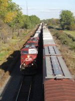 9781 leads CP train 143 west on Track 1 while being overtaken by 11G
