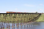 An Eastbound BNSF Grain Train Scoots Over the Luverne High Bridge