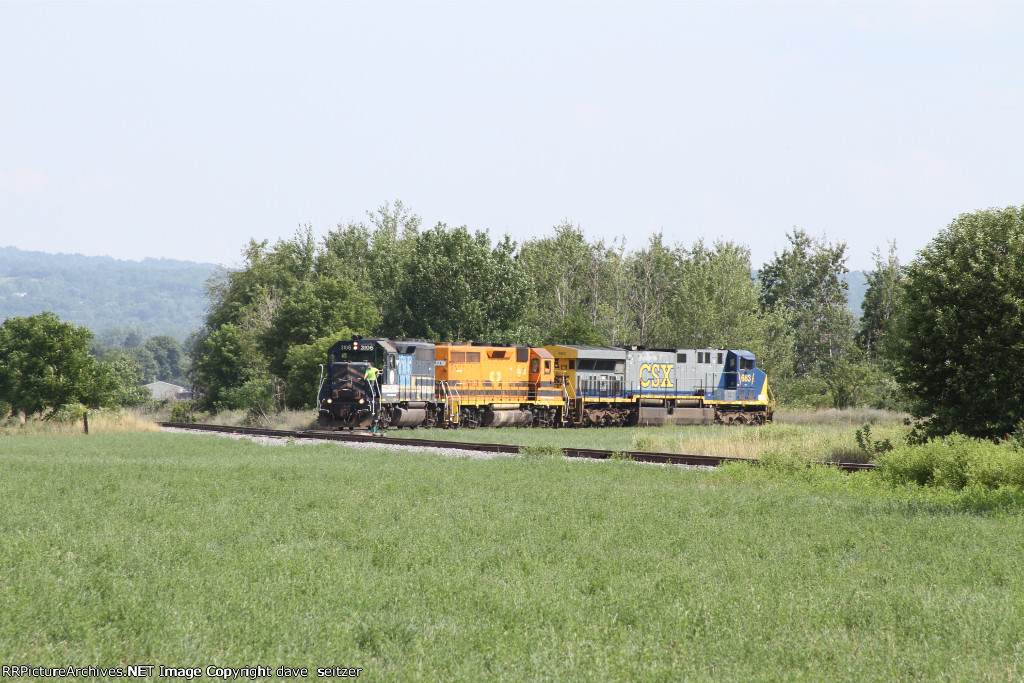 A pair of GP40's pull a refurbished CSX unit out of AMP.