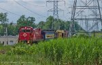 Under the high tension lines, the caboose train makes its way to the Merry Ln crossing.