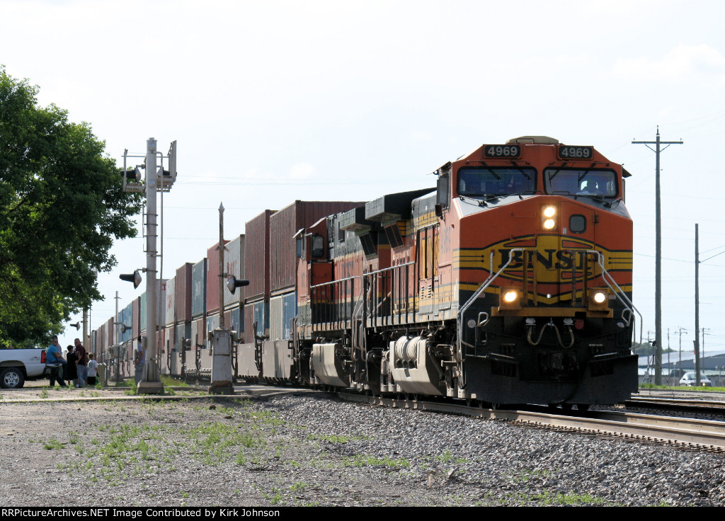 An Eastbound BNSF Stack Train Rolls by as Fellow Railfans Watch