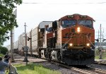 An Eastbound BNSF Stack Train Passes as a Railfan Gives a Wave
