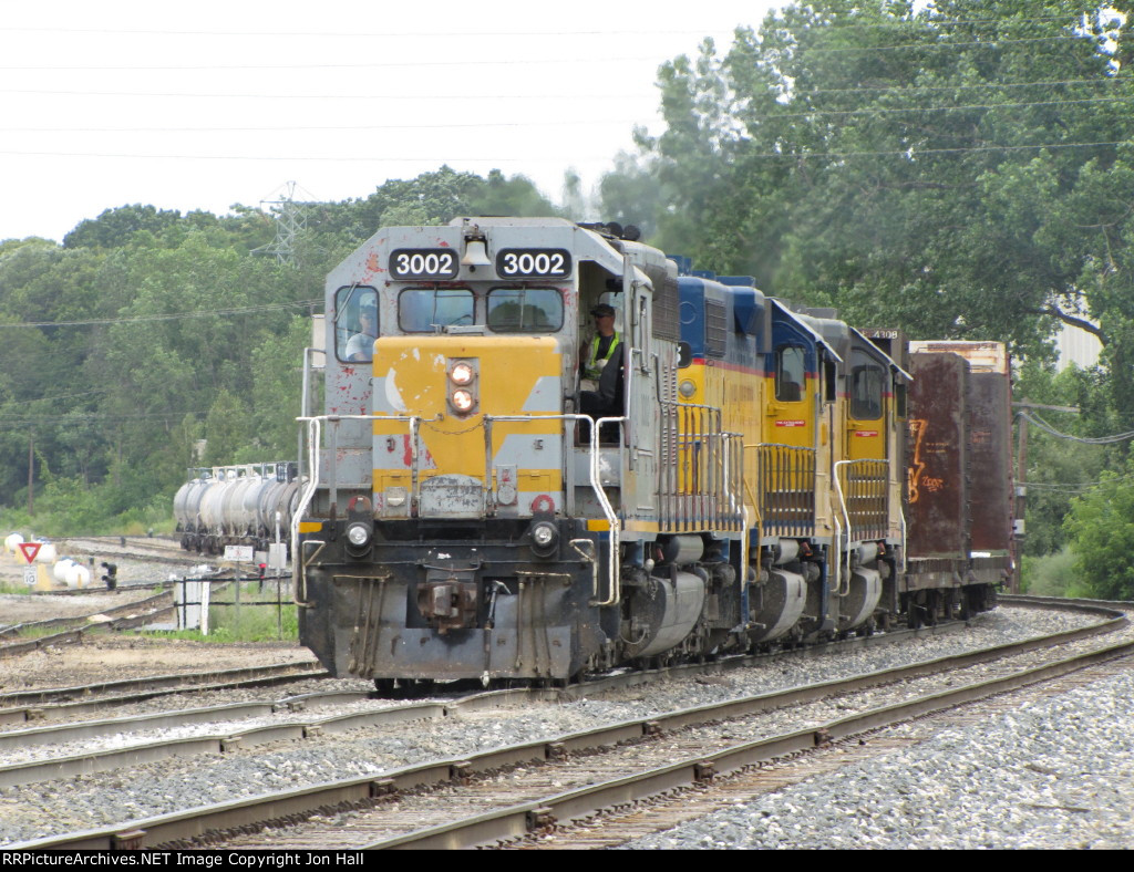 3002, 2005 and 2007 lead Z151-29 into the yard with a medium length train