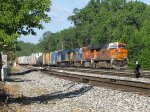 Weaving through Lamar from Track 2 to the Odd Side, BNSF & CSX power lead Q326-22 into Wyoming Yard