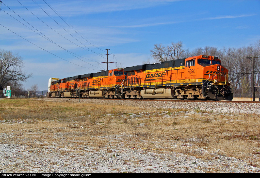 BNSF 7590 works Eb with a stack train At Nitoa IL,