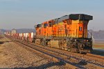 BNSF 7508 shoves Wb on a stack train.
