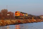 BNSF 9250 and bnsf 9494 leads a Wb freight along the Mississippi river.