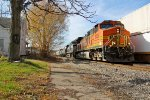 BNSF 5005 leads Eb freight past the Wb stack train.