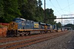 CSX ES40DCs 5216 and 5498 lead L034-26 through Woodbourne