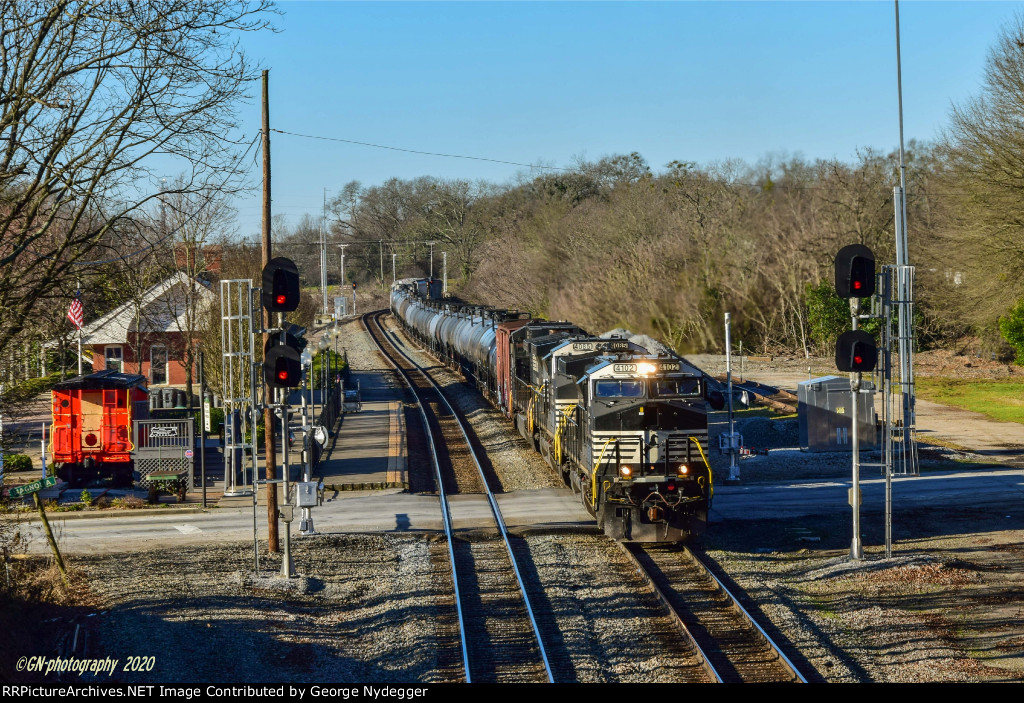 NS 4102 & 4085 leading a freight train by the AMTRAK station