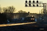 A golden moment: NS 1079 leads an early freight train by Arcadia Heights.