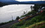 UP stack train heads east through Cascade Locks, OR at sunset