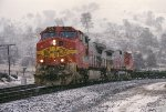 BNSF 727 ascending the snowy Techachapi Loop