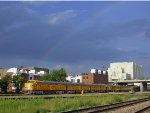 UP 951 leads the Aksarben Special during a summer storm with a rainbow forming overhead