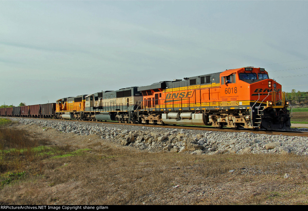 BNSF 6018 heads NB with a coal train and a good friend at the control.