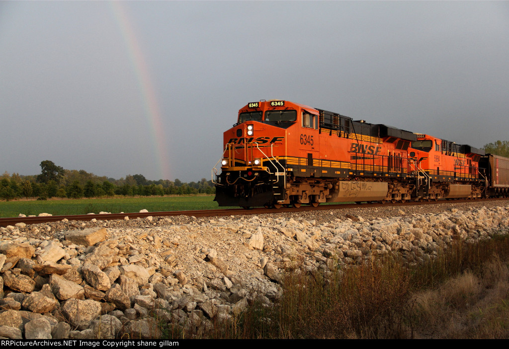 BNSF 6345 takes charge on this NB out of the storm to find a rainbow.