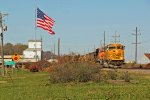 BNSF 9915 Gets under way Below Old Glory At Elsberry Mo.