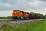 BNSF 6214 takes a empty ore train out of the storm clouds.