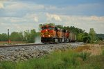 BNSF 5734 leads a empty coal train out of the storm clouds.
