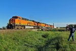 BNSF 5883 brings this nb freight out of the siding.