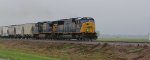 CSX 4561 hauls a freight sb with csx power with the remains of hurciane isac still around.