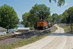 BNSF 6370 leads a eb coal along the river.