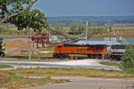 BNSF 7431 takes a loaded coal train out of the siding NB.