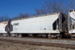 NS 243630, leaking its white powder lading (kaolin?) and coating the cars that follow. NS train #338,