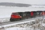 M34371-29 northbound at Amherst, WI kicks up fresh snow.