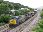 Five CSX units of five models slowly pull away from Wyoming Yard leading Q334