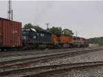 Q334 heads away toward Plaster Creek led by one unit each from HLCX, BNSF, IC&E, CP & CSX