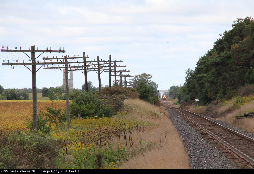 In the distance, CP 8786 approaches with the 608