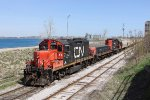 A yard job starts its shove north along the St Clair River on the Point Edward Spur with another cut of grain empties