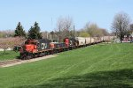 CN 7253 continues its shove north through Centennial Park and across Front St