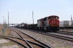 CN 8860 & 2402 slowly pull M385 west as its gets its customs roll by