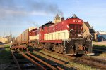 The very rare combination of an Alco S6 and an MLW S13 roll west through Ingersoll with autoracks