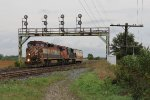 M331 pulls west into the plant at Paris West with one idler car for their pick up out of the siding