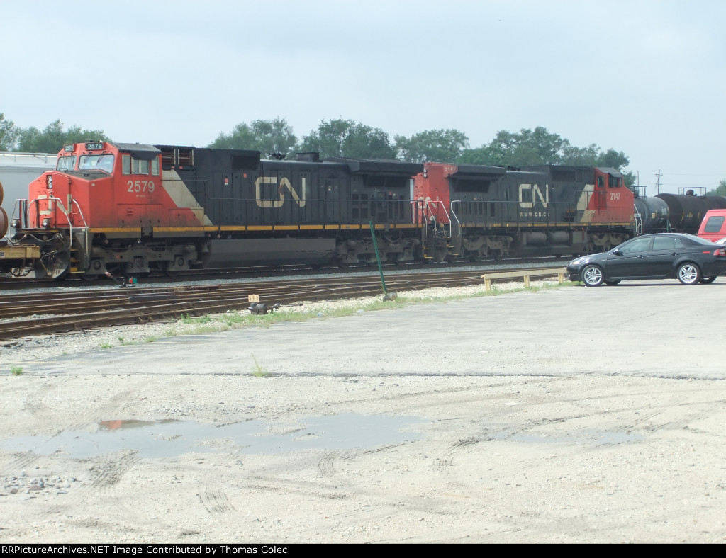 CN 2147 and 2579 lead a manifest north through East Joliet Yard